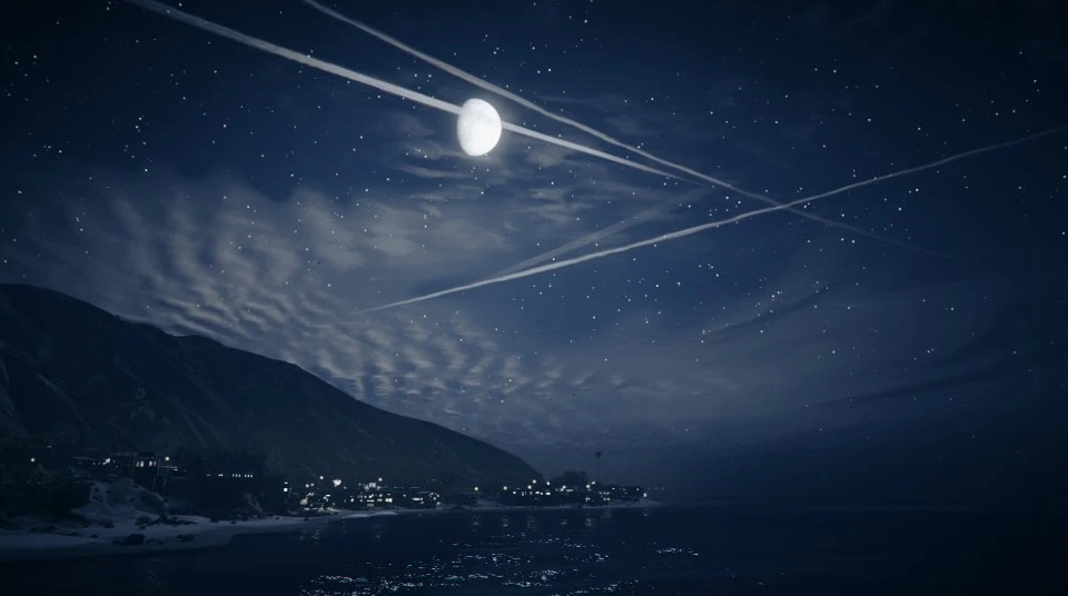 Picture of a landscape in GTA online from the pier at night. There's a mountain, the sea, the moon, the stars and some chemtrails.