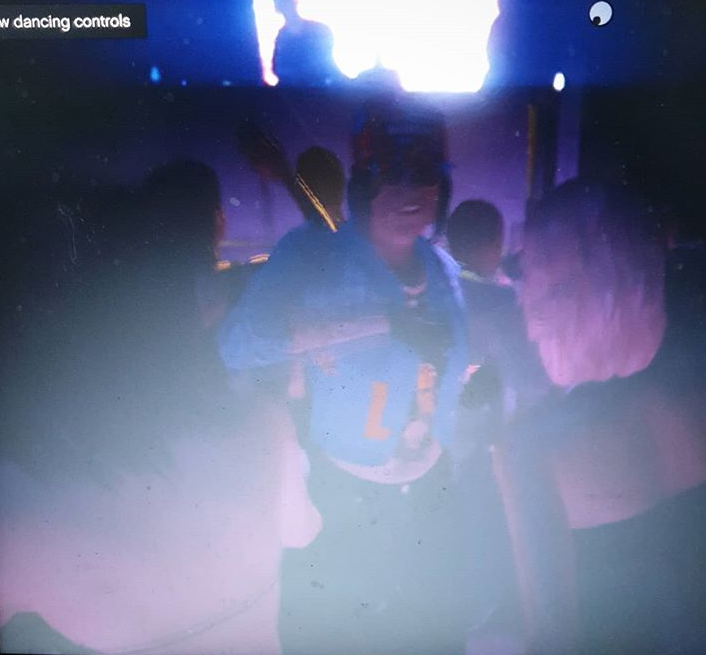 Character from GTA Online dancing at a nightclub. The Blessed Madonna playing in the background. The character is happy, wearing sunglasses and a trucker hat.